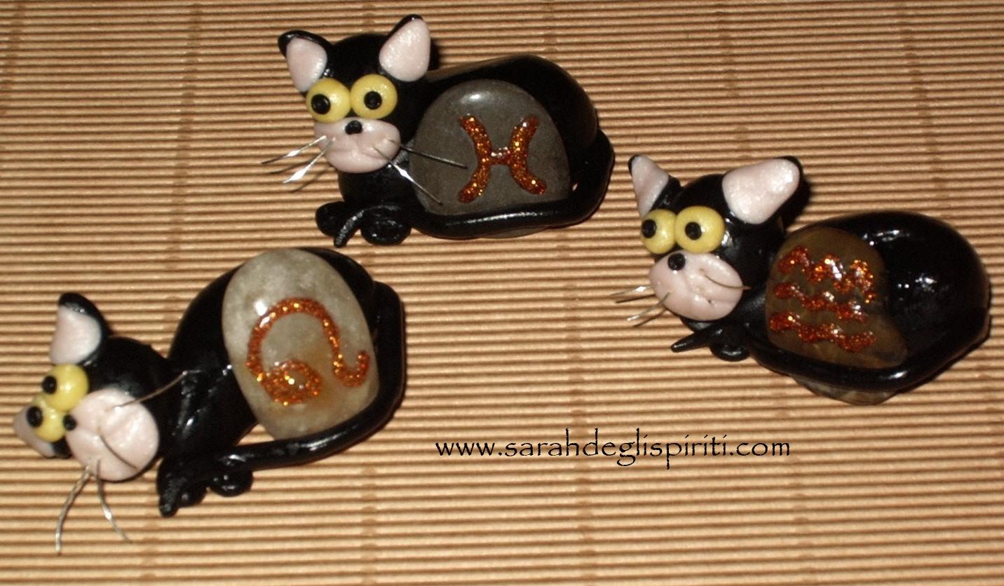 Gatti segna posto con segni zodiacali